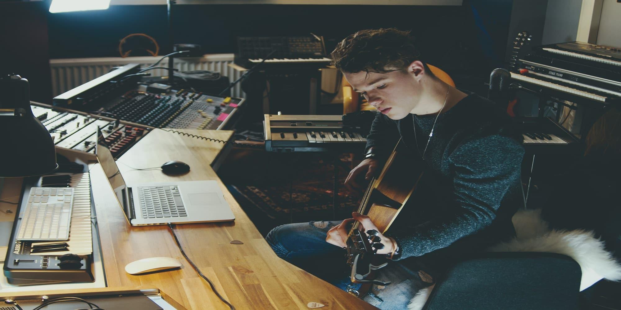 guy making music